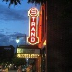 Strand theater sign all lit at night