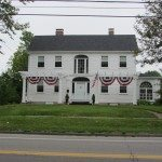 Capatin's home on main street decorated for the fourth of July.