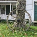 Wagon wheel on front lawn in Washington Village, Washington, Maine
