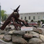 """World's Largest Lobster"" at the Tradewinds Motor Inn in Rockland, Maine. The Maine Lighthouse Museum in is the background."