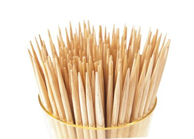 A lot of toothpicks in the cup. On a white background.